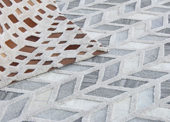 Delhi: Tufted rug made with natural cow leather, viscose rug and rug  Hand made sewing