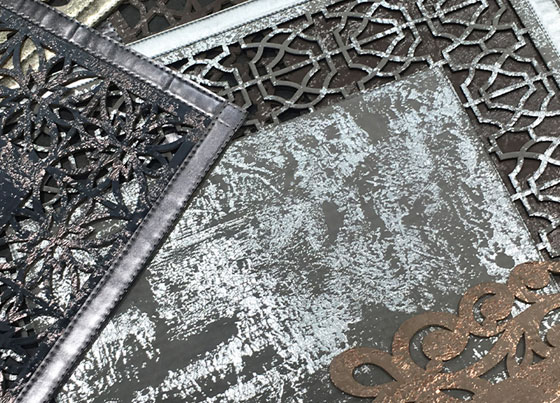 Bianca: Elegant leather look carpet with classical and modern bordures