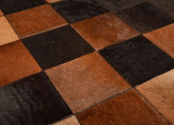 Leather Rug: Handmade patchwork rug manufactured by using natural cow leather imported from Southern America